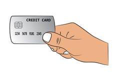 有信用卡的手 库存图片