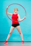 有做锻炼的hula箍的适合的妇女 图库摄影