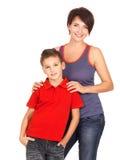 有儿子的愉快的年轻母亲 免版税图库摄影
