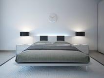 有先进的照明设备家具的现代卧室 免版税库存照片