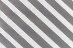 有光和阴影纹理的灰色墙壁 免版税库存照片