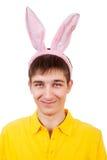 有兔宝宝耳朵的少年 库存照片