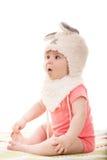 有兔宝宝耳朵的惊奇女婴 免版税库存照片