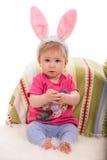 有兔宝宝耳朵的婴孩复活节 免版税图库摄影
