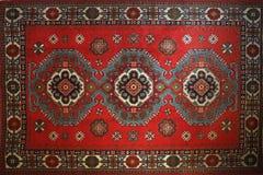 有全国东方人的老地毯 库存照片