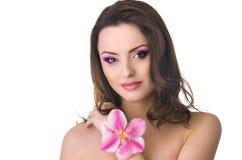有兰花的美丽的妇女 免版税库存照片