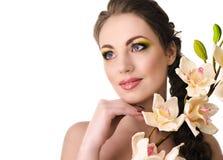 有兰花的美丽的妇女 免版税库存图片