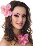 有兰花花的美丽的妇女 库存照片