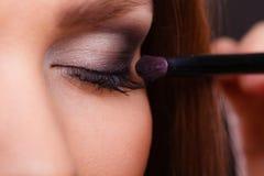 有典雅的眼睛的迷人的妇女组成 库存图片