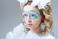 有冬天样式构成的美丽的妇女 免版税图库摄影