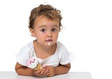 有冰淇凌的婴孩 免版税图库摄影