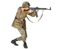 有冲锋枪的战士。 隔绝在白色背景 库存图片