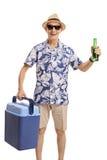 有冷却的箱和一个瓶的年长游人啤酒 库存照片