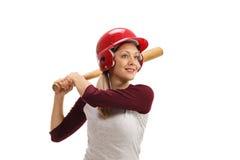 有准备好一个的木棒的女性棒球运动员触击 库存照片