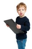 有大计算器的逗人喜爱的男孩 免版税库存照片