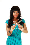 有刀子和叉子的女孩。 免版税库存图片