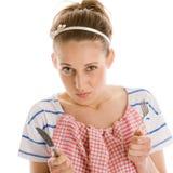 有刀子和叉子的饥饿的妇女 库存图片