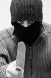 有刀子的强盗 免版税库存照片