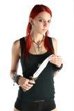 有刀子的红色头发女孩 免版税图库摄影