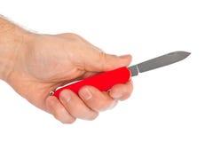 有刀子multitool的手 图库摄影