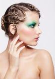 有创造性的发型的妇女 免版税库存图片