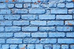 有削皮油漆背景纹理的蓝色砖墙 免版税库存照片