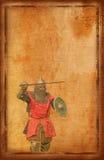 有剑和盾的-减速火箭的明信片装甲的骑士 库存照片