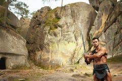 有剑的强有力的年轻战士 库存照片