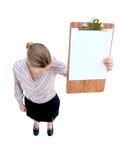 有剪贴板的垂头丧气的妇女 免版税库存照片