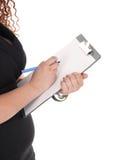 有剪贴板的女商人 免版税库存照片