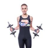 有加大完善的强的强健的身体佩带的运动服的田径服的性感的运动少妇干涉与哑铃孤立 免版税图库摄影
