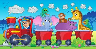 有动物的火车在风景 库存照片