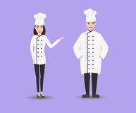 有助理的微笑的餐馆厨师怪人 被隔绝的男人和妇女厨师 免版税库存照片