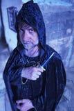 有匕首的严肃的魔术师 库存照片