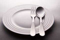 有匙子和叉子的牌照 图库摄影