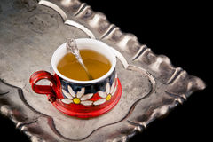 有匙子的茶杯 免版税库存图片