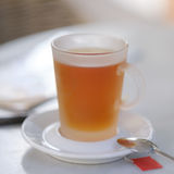 有匙子的茶杯 免版税图库摄影