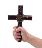 有十字架的手 免版税库存图片
