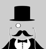 有单片眼镜和髭的人 免版税库存照片