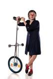 有单轮脚踏车的小丑 图库摄影