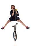 有单轮脚踏车的小丑 库存照片
