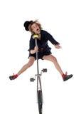有单轮脚踏车的小丑 免版税库存照片