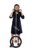 有单轮脚踏车的小丑 免版税库存图片