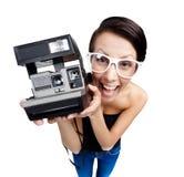 有卡式磁带照相机的兴高采烈的妇女 库存照片