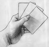 有卡片剪影的手 图库摄影