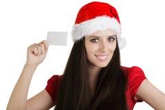 有卡片的圣诞节女孩 免版税图库摄影