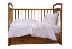 有卧具的木轻便小床 库存照片