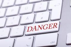 有危险词的高端铝键盘在对此的红色 库存照片