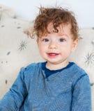 有卷发的男婴 图库摄影