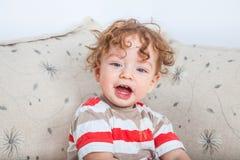 有卷发的男婴 免版税图库摄影